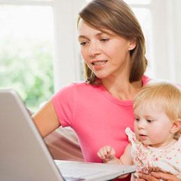 woman baby laptop